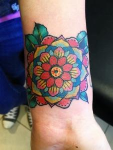 geometric flower on wrist