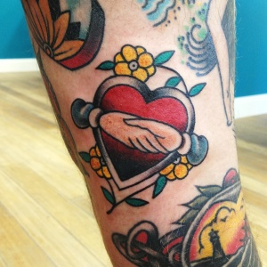 heart and hands tattoo