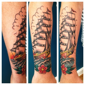 ship tattoo with flower