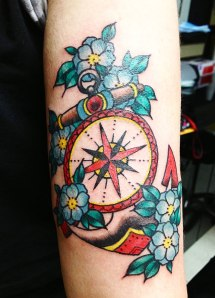 anchor, compass and flowers tattoo