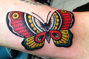 butterfly and blue flowers tattoo