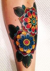 two geometric flowers tattoo