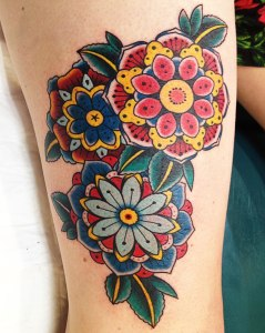 three geometric flowers tattoo