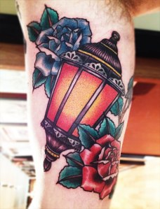 lamp tattoo with roses