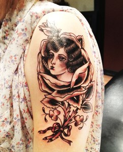 Girl head in rose, black and grey tattoo