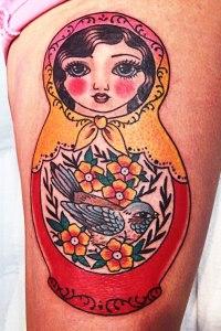babushka doll with bird tattoo