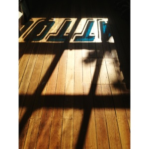 Early morning sunlight casting a shadow from our window signage.