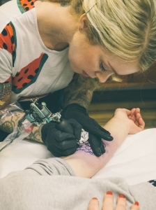 A photo of me tattooing at MTCo taken by Rol rolexshitthebed.com