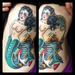 mermaid rib piece tattoo